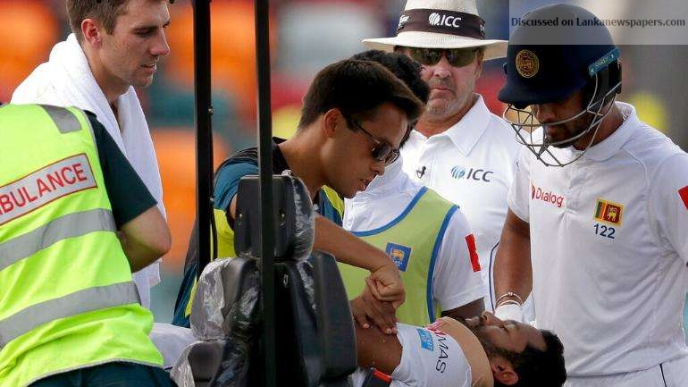 Sri Lanka News for Dimuth hit by bouncer and stretchered off